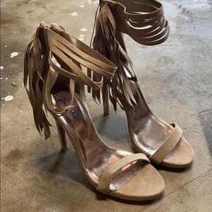 Nude strappy heels with tassel